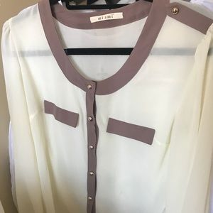 Cream blouse with gold buttons